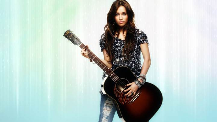 Miley Cyrus Guitar in Hand Looking Front Photoshoot